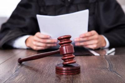 judge reviewing divorce documents
